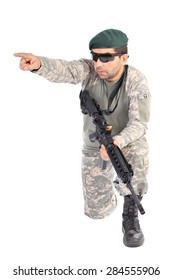 Portrait of soldier or commander holding his rifle and pointing  with finger over white background