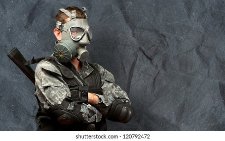 Portrait Of A Soldier With Gas Mask against a grunge background