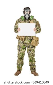 Portrait of a soldier with gas mask holding white sheet of paper against white background