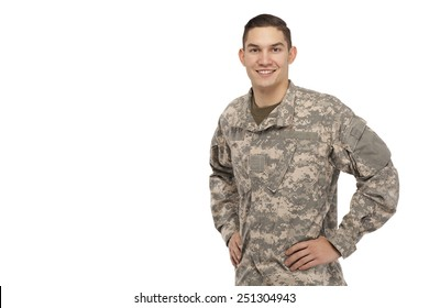 Portrait of soldier posing with hands on hips