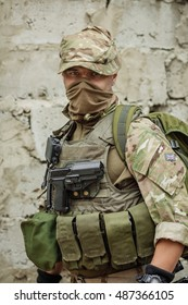 Portrait soldier or private military contractor holding sniper rifle. war, army, weapon, technology and people concept.