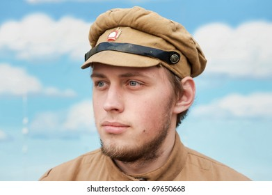 Portrait of soldier in uniform of World War 1 on the background of blue sky. Costume accord the times of World War I. Photo made at cinema city Cinevilla in Latvia.