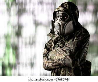 portrait of soldier wearing gas mask waiting against a abstract background