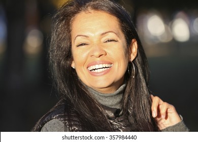 Portrait Of A Spanish Mature Woman Smiling At The Camera