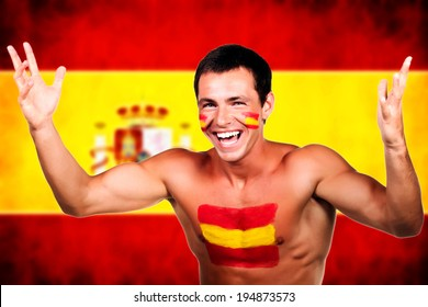 Portrait of a spanish soccer fan over spain flag background