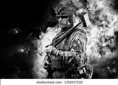 Portrait of a special forces soldier waving a sledgehammer to smash an obstacle. The concept of military units. Computer games. Mixed media