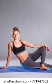 Portrait of sport girl doing yoga stretching exercise. yoga