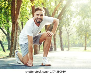 The Portrait Sport Used Man dressed in jogging in the park.