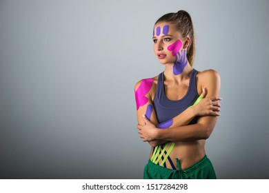 Portrait of sports woman. therapeutic tape glued to the body