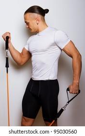 Portrait of sportsman in sport wear with rubber band