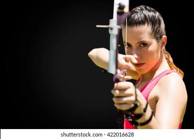 Portrait of sportswoman practising archery