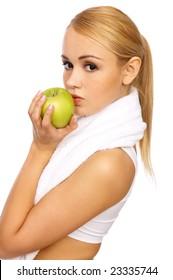 Portrait of Sporty beautiful girl holding apple