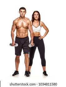 Portrait of sporty healthy young man and woman with dumbbells
