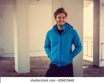 Portrait of sporty man in a blue jacket.