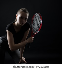 Portrait of sporty teen girl tennis player with racket