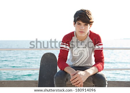 portrait sporty teenager boy sitting on stock photo (edit now
