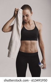 Portrait of sporty young woman tired after a gym workout