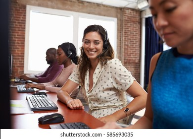 Portrait Of Staff In Busy Customer Service Department Shot