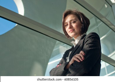 Portrait of a standing businesswoman with crossed arms