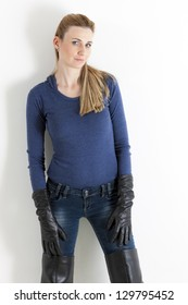 portrait of standing woman wearing jeans