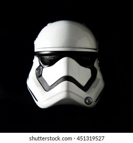 Portrait of a Star Wars The First Order Stormtrooper helmet on a black background with dramatic lighting