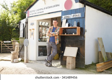 Portrait Of Stone Mason Standing Outside Workshop