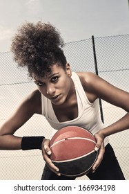 Portrait of a street basket player holding the ball