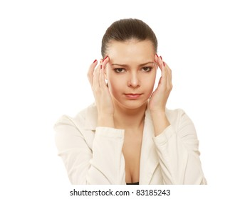 Portrait of stressed business woman having head pain over white background