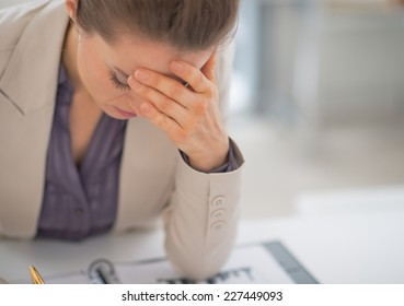 Portrait of stressed business woman in office