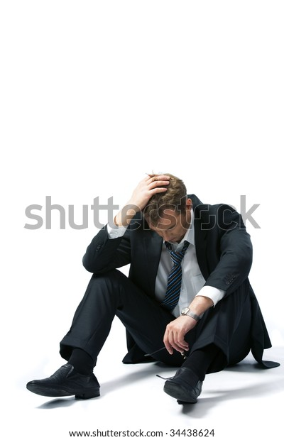 Portrait of stressed businessman touching his head and thinking about future