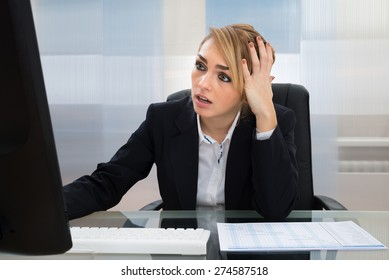 Portrait Of Stressed Businesswoman Working On Computer In Office