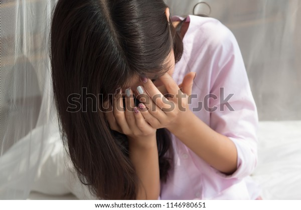 portrait of stressed, hopeless woman with face palm gesture; depressed woman doing facepalm, suffering from stress, depression, life problem; mental health concept; 20s young adult asian woman model