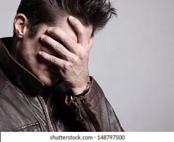 Portrait of stressed men