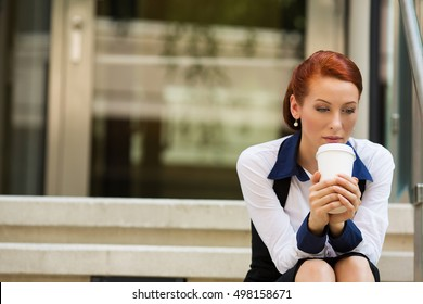 portrait stressed sad young woman sitting outdoors corporate office. City urban life style stress