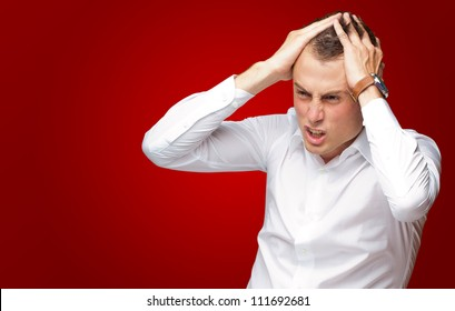Portrait Of Stressed And Suffering Man On Red Background