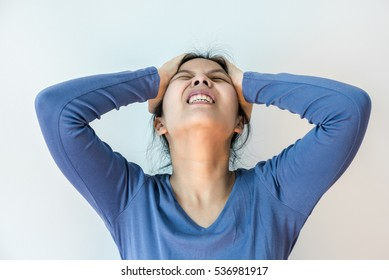 Portrait of a stressed woman holding head in hands