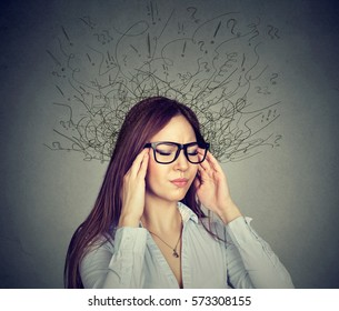 Portrait stressed young business woman having headache with worried face expression and brain melting into many lines question marks. Obsessive compulsive, anxiety disorders  concept