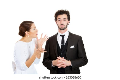 Portrait of stressed young couple going through hard times in relationship, isolated on white background. Upset, angry, mad wife, girlfriend trying to prove her point to clueless, annoyed man, husband