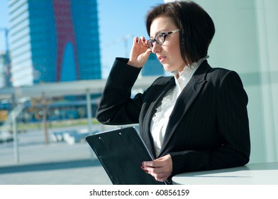 Portrait of a strict businesswoman with glasses