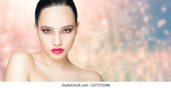 Portrait of striking brunette beauty in strong makeup.