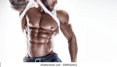 portrait of strong Athletic Fitness man showing big muscles over white background