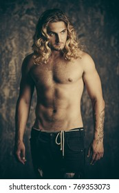 Portrait of a strong healthy handsome athletic man. Male beauty concept. Fitness, bodybuilding.