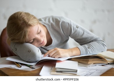 Portrait of a student girl sleeping at the desk, education concept photo, lifestyle