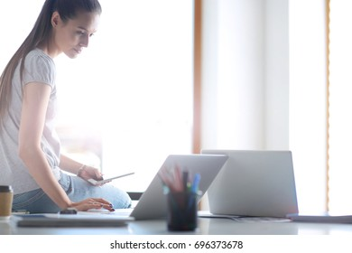 Portrait of student girl working on laptop. Student girl