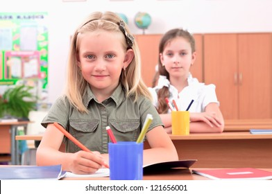 portrait of students in the classroom, sit at school desks