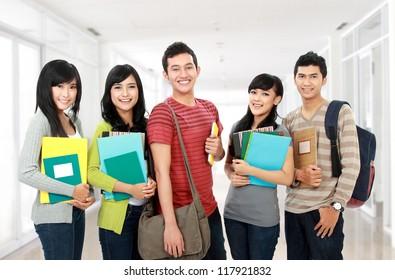 portrait of students holding notebooks at school university