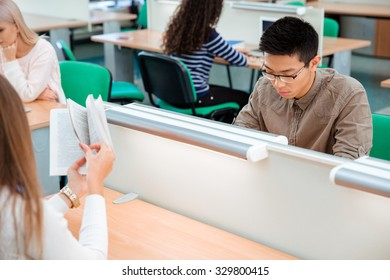Portrait of a students studying in library
