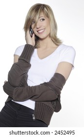 portrait in studio on a white background of a young blond caucasian smilling woman  holding a mobile phone