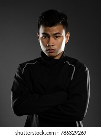 Portrait studio of a young handsome asian sport man