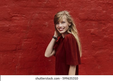 Portrait of stunning woman in red dress